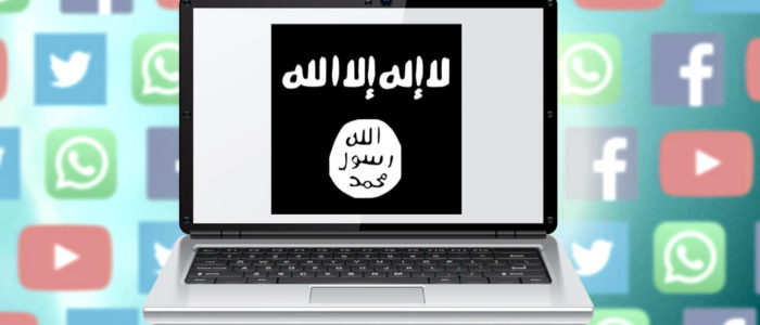 A laptop with an image of various social media platforms and arabic text on the screen